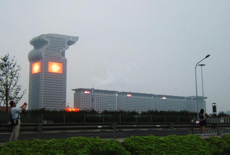 求解,为什么象征中国龙图腾的盘古大厦