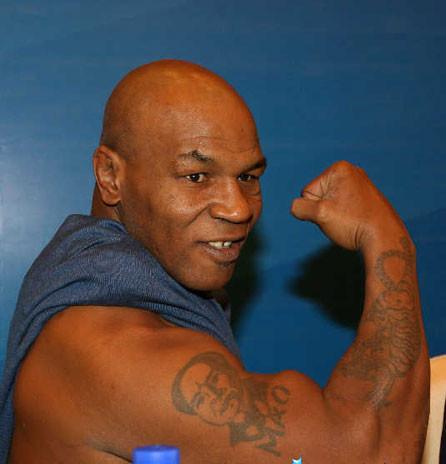 问世界拳王 泰森:请问你手背上为什麽要纹奇怪的纹身图片图片图片