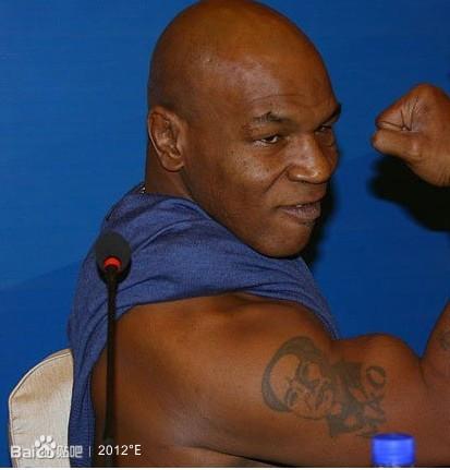 为什么拳王泰森手臂上的纹身是毛主席的头像?图片
