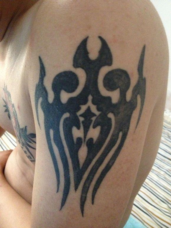 纹身半年后有地方痒怎么办图片