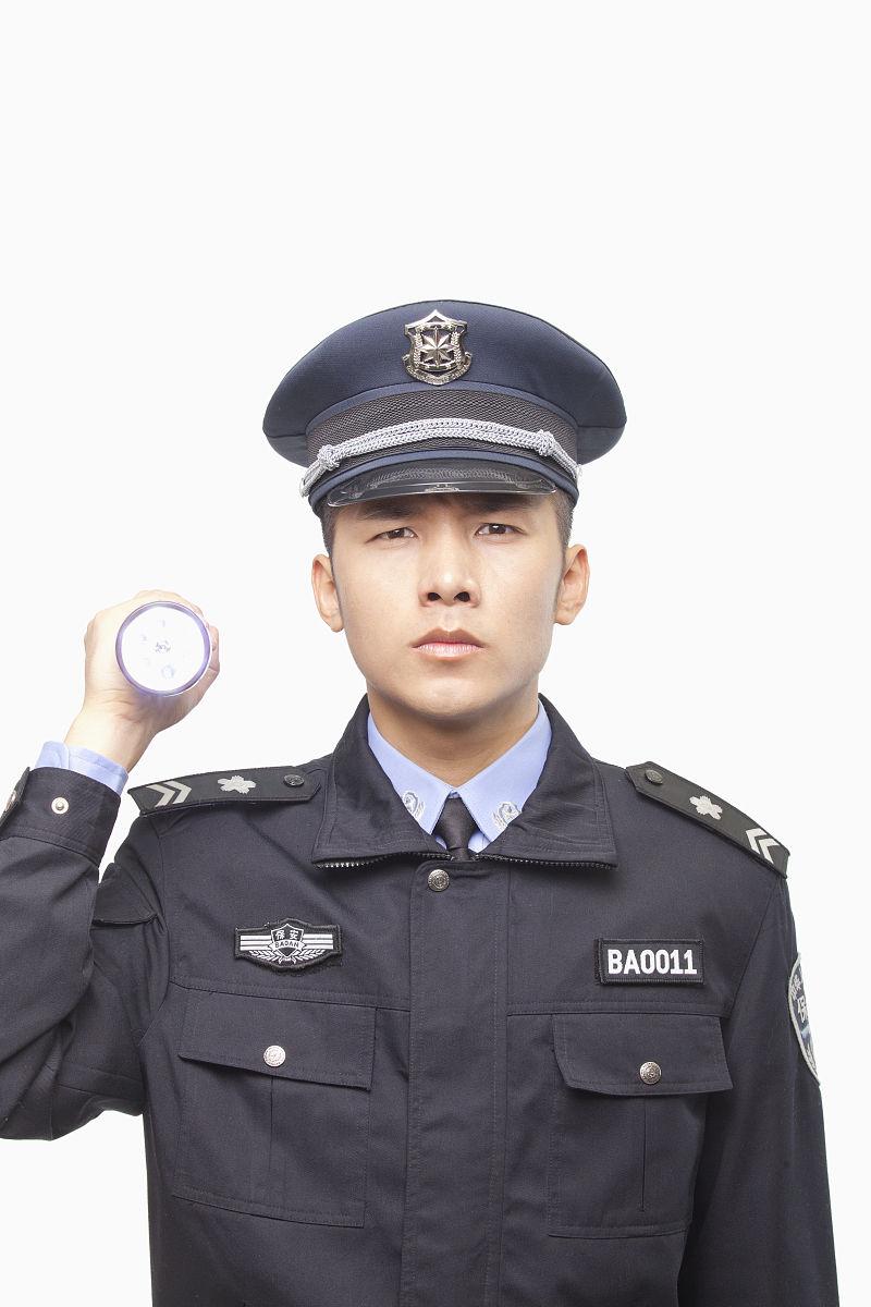 警官�y�-��+_警官闪光手电筒,工作室拍摄