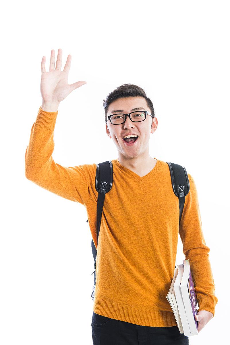 一个打招呼的年轻男性图片