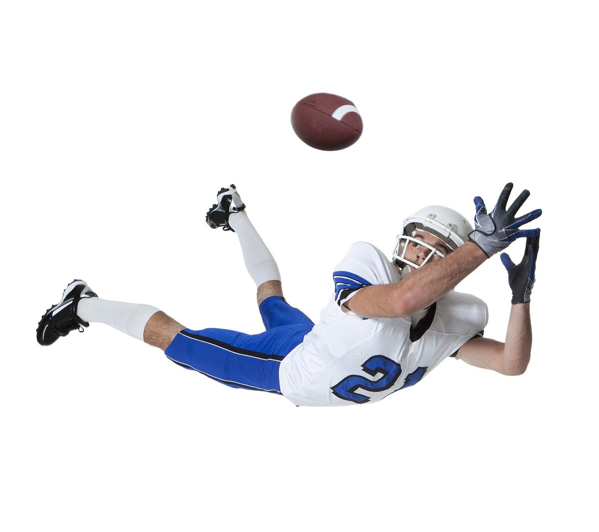男子美式橄榄球接球球,摄影棚图片