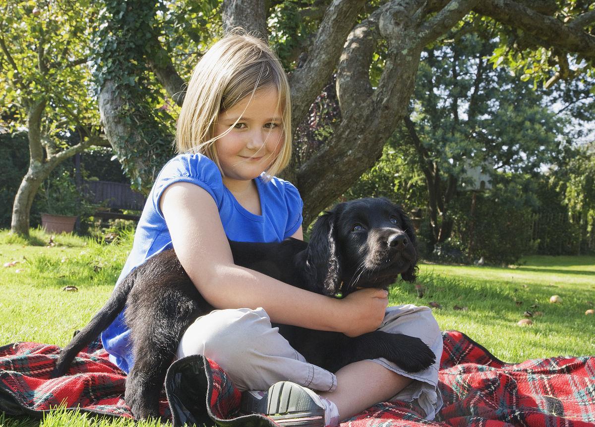 年轻女孩,宠物狗.图片