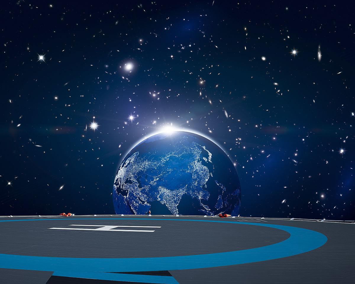 奇幻星空发光地球背景的直升机停机坪图片