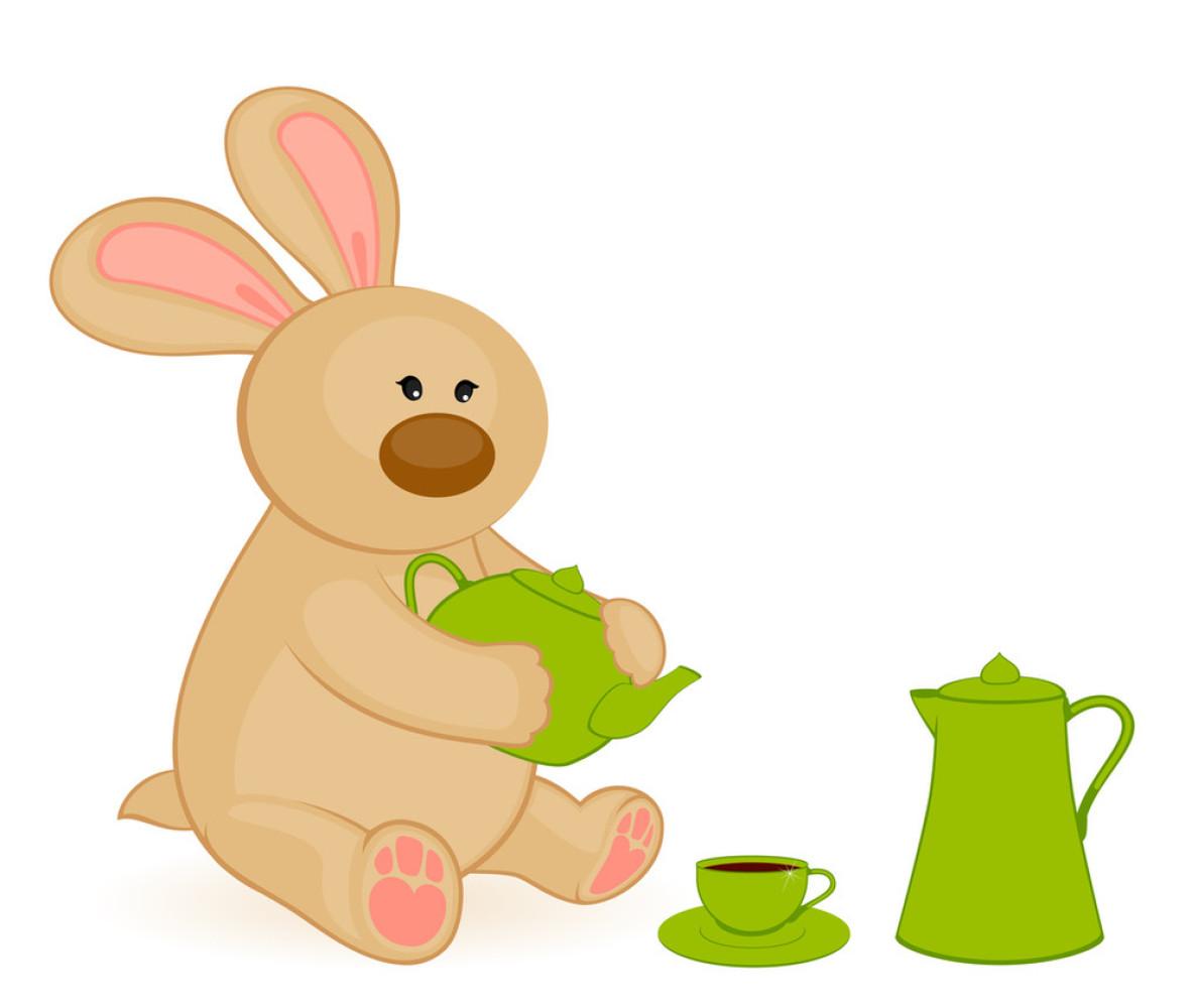 卡通小玩具兔与美丽的杯子和茶壶图片