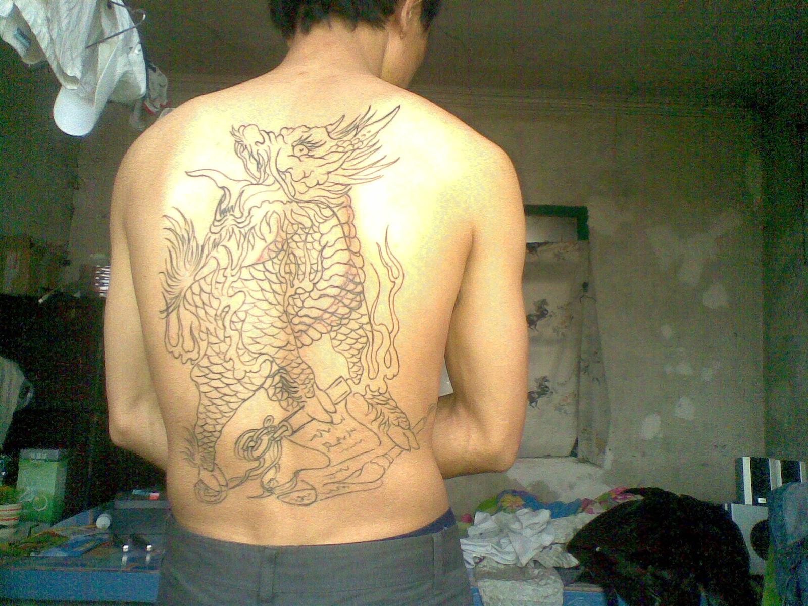 鲤鱼跳龙门纹身讲究_满背下麒麟纹身多图_纹身麒麟割线图片