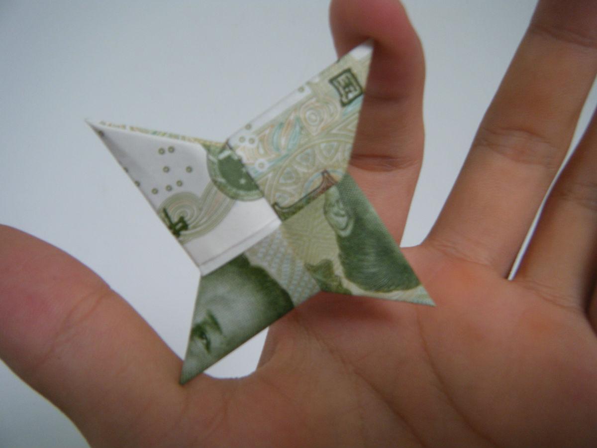 如何用纸币折玫瑰花_怎么用一元纸币折 - www.iaidaw.com